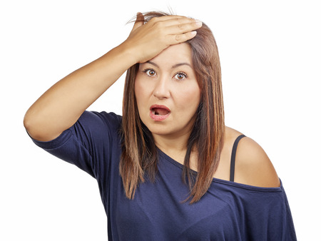 hand on forehead: Worried woman gesturing forgotten something with hand on forehead isolated Stock Photo