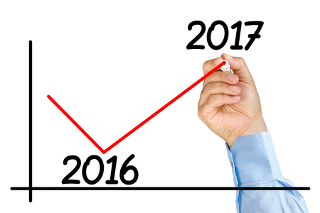 Businessman hand with marker drawing changing improvement graph for 2017 year isolated Stock Photo - 63679176
