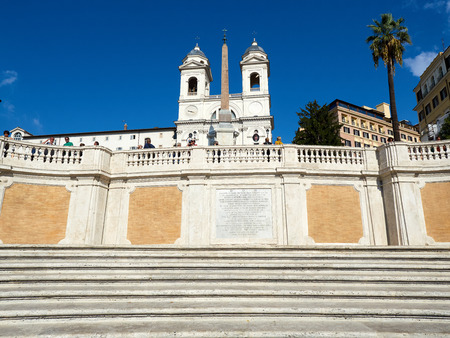 Rome, Italy - Sept 2016: The Spanish Steps and Trinita dei Monti (Trinity of the Mountains) church in Piazza di Spagna