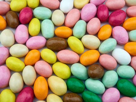 sugared almonds: Bunch of colored sugared almonds closeup background Stock Photo
