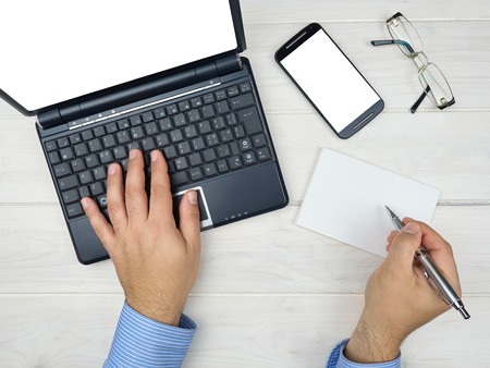 Topview businessman working at desk with laptop smartphone Stock Photo