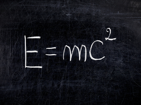 equivalence: Formula E=mc2 theory of Relativity on balckboard or chalkboard