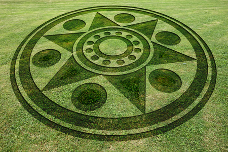 Concentric circles and star fake crop circle in the meadow