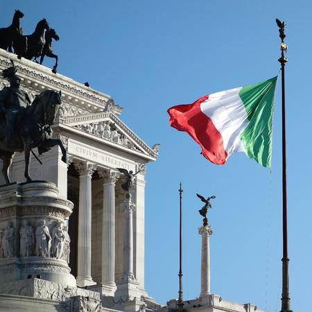 Italian Flag waving Altar of the Fatherland or Altare della Patria in Rome Italy