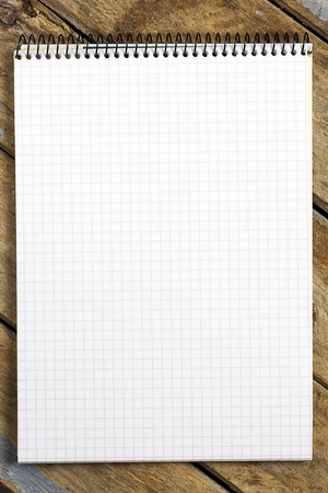 sheet of paper: White spiral squared notebook on rustic wooden table viewed from above Stock Photo
