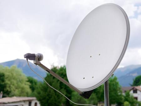 Dish parabolic antenna on the balcony