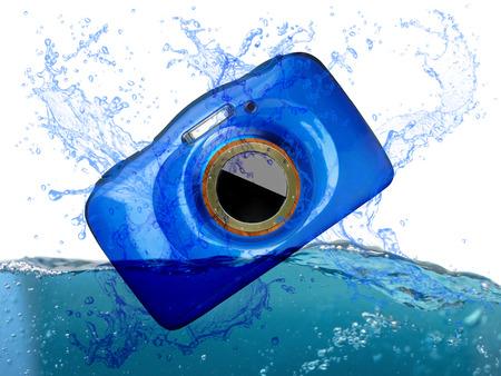 waterproof compact digital camera splashing into water Stock Photo
