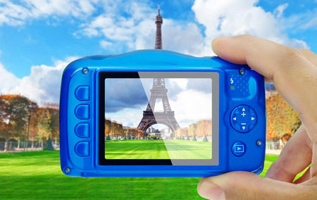 Taking picture of eiffel tower paris compact camera display pov Stock Photo