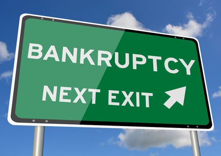 Bankruptcy signpost or roadsign next exit blue sky