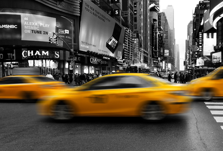 New York City, USA - April 2018: taxis in midtown Manhattan selective color