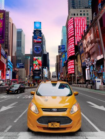 New York City, USA - April 2018: Yellow taxi in Times Square