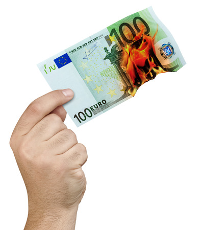 Hand holding 100 euro banknote burning in flames isolated Stok Fotoğraf