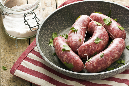 Raw Sausages in a Pan Banco de Imagens