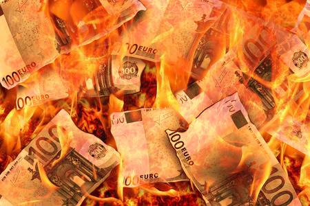 100 euro banknotes burning in flames