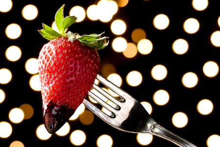 Romantic Chocolate Dipped Strawberry on a Fork Stock Photo