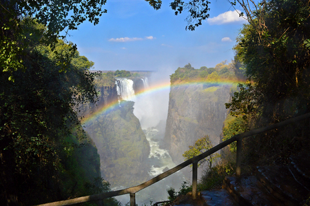 Victoria Falls and rainbow formed in the water spray Zambezi River Zimbabwe Africa