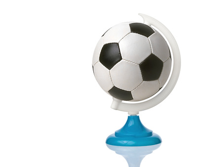 Soccer or football ball in place of earth planet globe isolated Imagens