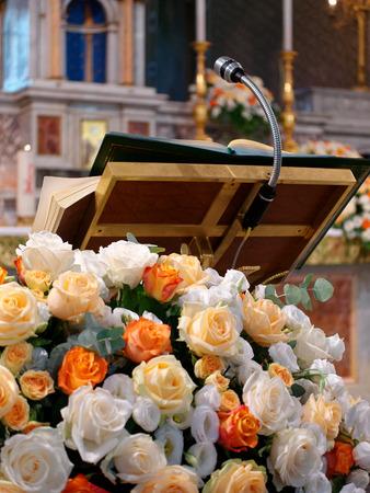 Pulpit with floral decoration church Stock fotó