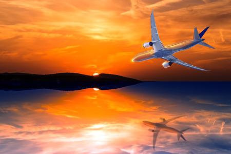 Airplane flying toward sun at sunset or sunrise at sea Reklamní fotografie
