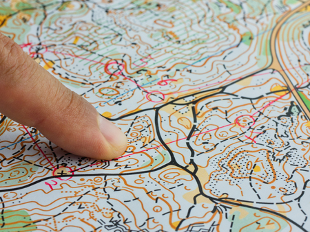 Finger close up on orienteering map