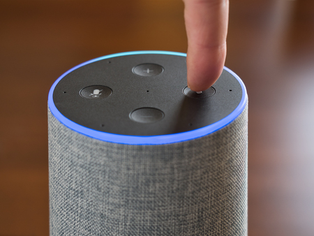 Smart speaker artificial intelligence assistant voice control blue ring Фото со стока