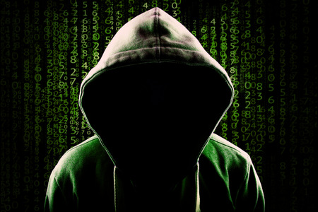 Computer Hacker. Faceless hooded anonymous against programming code background