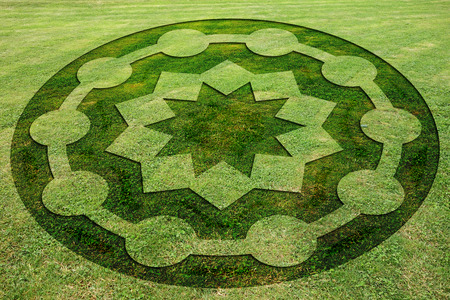 Concentric circles and stars symbols fake crop circle in the meadow
