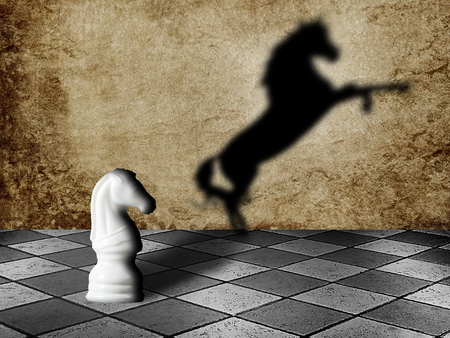 Chess horse with shadow as a wild horse on a chessboard. Potentiality concept 스톡 콘텐츠