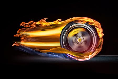 Speedy wheel on fire on the road 免版税图像