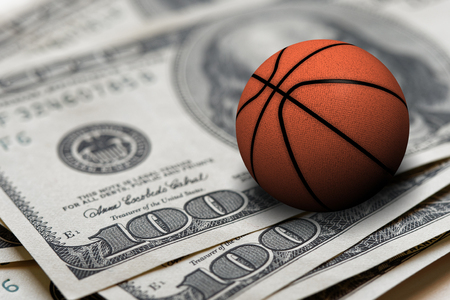 basketball ball on 100 dollars bills closeup