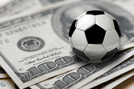 Soccer or football ball on 100 dollars bills closeup Stock Photo
