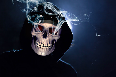 Scary hooded human skull. Death Portrait at night