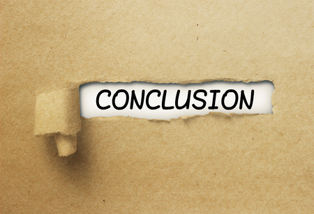 Conclusion behind ripped curl paper Stock Photo
