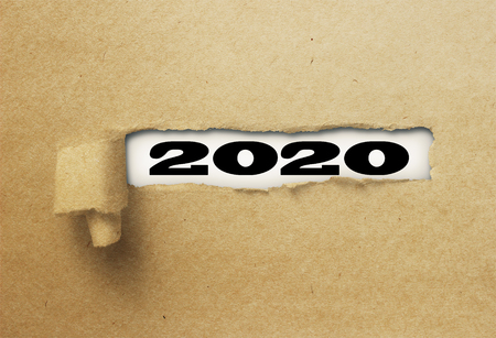 ripped or torn paper revealing new year 2020 on white background