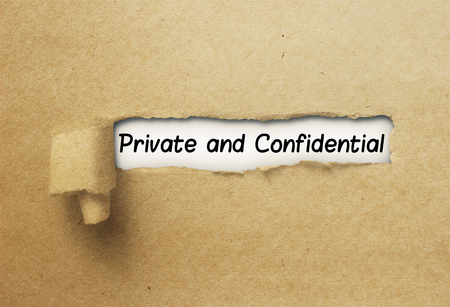 Private and Confidential behind ripped curl paper