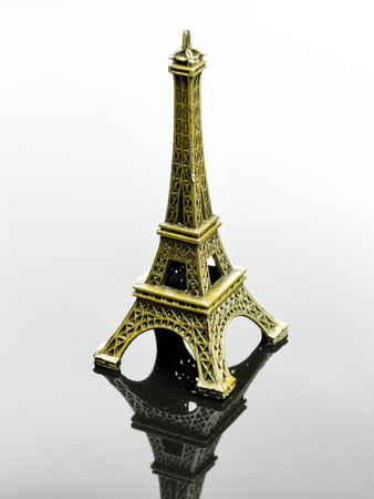 Small Eiffel tower Paris souvenir with reflection