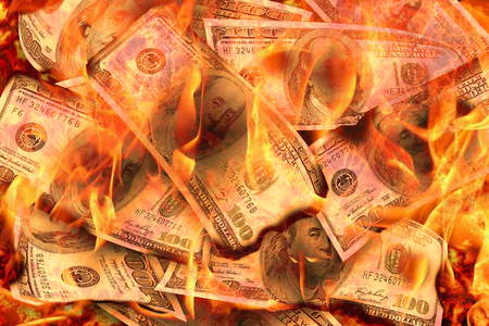 Dollars Banknotes or bills of United States of America dollars burning in flame concept of crisis, loss, recession or failure Banco de Imagens - 122392954