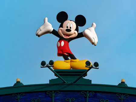 Paris, France - April 2019: Statue of mickey mouse against light blue sky  at disneyland funfair Editöryel