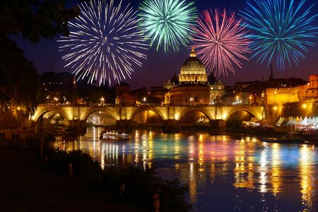 Fireworks on St peter Cathedral skyline in Rome view from Umberto I bridge on Tiber river Reklamní fotografie - 126252178