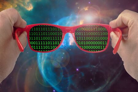 male hands holding sunglasses looking at digital universe at binary code exploration concept