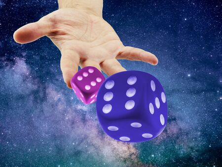 Hand Throwing or rolling Dice in the cosmo or universe. Causality or randomness concept