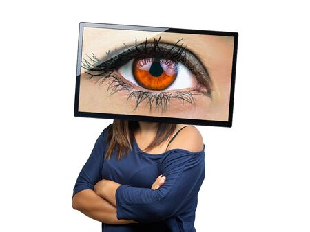 big female eye on tv screen looking isolated. Big Brother is watching you. Conceptual image. Reklamní fotografie