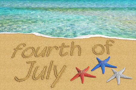 Fourth of July text inscription on the sand shore tropical clear sea. Independence day Imagens