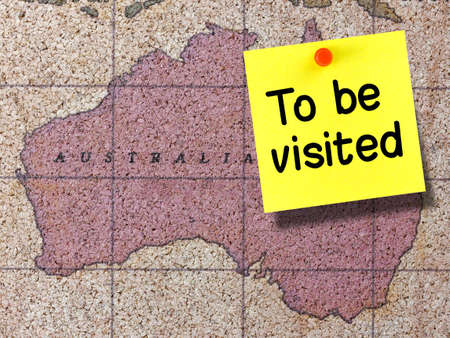 To be visited sticky note on cork map of Australia