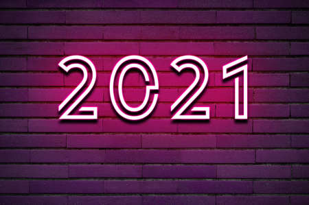 2021 glowing neon text on brick wall