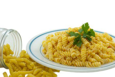 Fusilli and tomato sauce isolated over white photo