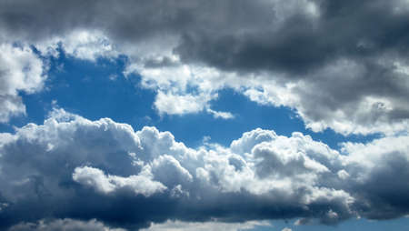 Blue Sky and Dark Clouds Stock Photo