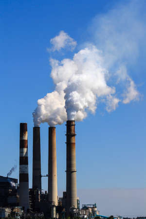 Image of a factory with smoke stacks photo