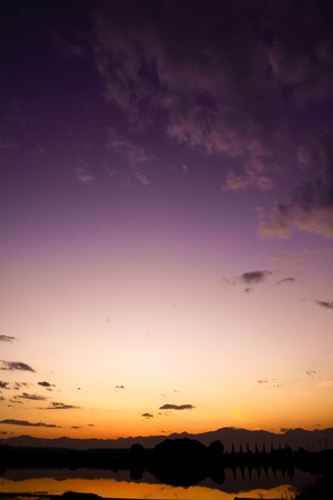 Sunset in the evening sky with purple, yellow. Very very beautiful photo