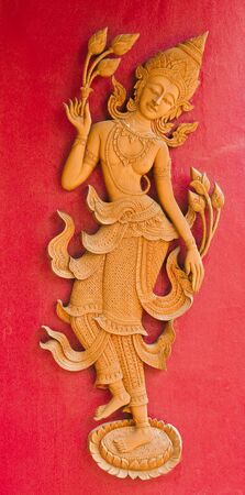 Carved wood relief Sung art in northern Thailand photo